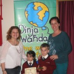 The children, together  with Ms I. Farrugia  (Dinja Waħda co-ordinator) &  Ms. L. Ebejer )