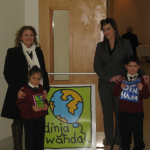 Ms I. Farrugia (Dinja Waħda Coordinator) and Ms R. Spiteri Mercieca (School Council Member) together with the children.